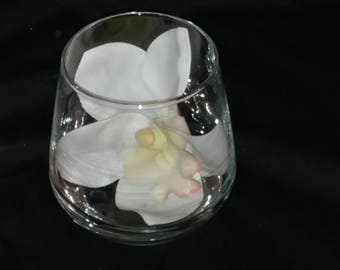 Cymbidium orchid blossom in glass cup