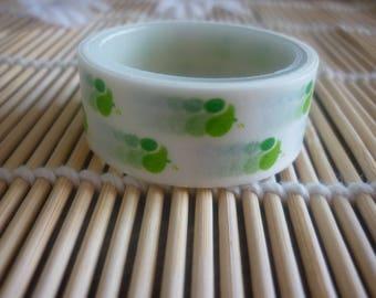 Masking tape white drops and slippery green polka dots.