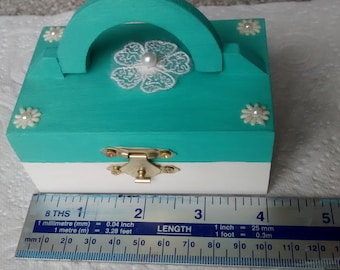 Wooden trinket box with flowers.