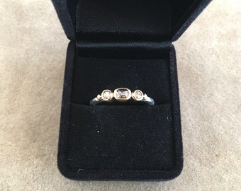 A hand-made 18ct gold & stg silver ring set with 3 rose-cut diamonds