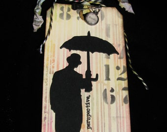 Umbrella Man Tag, Gift Tag, It's All Perspective, Tim Holtz Die Cut, Multicolored Rain, Man With Umbrella, Bowler Hat Man, Man in Bowler Hat