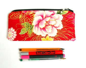 Floral pencil pouch. Floral pencil case. Red and gold pencil pouch. Zipped pouch. Zipped gadget pouch. Padded pencil case. Big pencil case