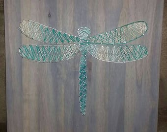 Handmade dragonfly or butterfly string art