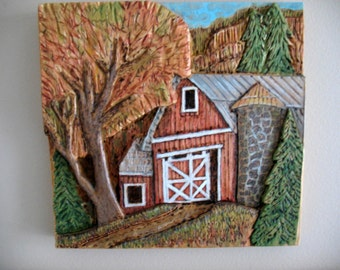 Relief carving of a barn and silo in a rural setting