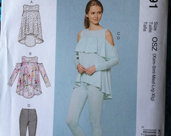 McCalls 7691, Misses' Tops and Pants, Ruffle Yoke Top, Cold Shoulder, Leggings, Shaped Hem, New uncut sewing pattern