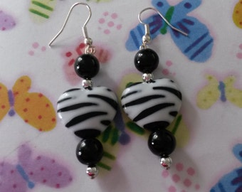 Black and white earrings with a striped  heart