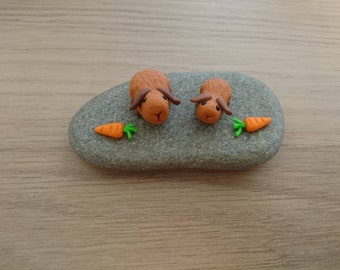 Guinea pig miniatures . Made from Fimo. Mummy and baby