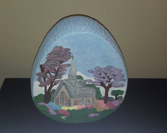 Ceramic egg with church in spring scene