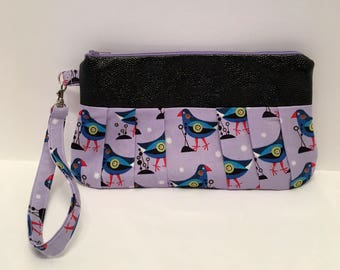 AK33- Compleat Clutch: in a quirky bird print with pleated front, zipper closure and detatchable hand strap
