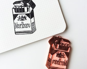Marlboro stamp.hand carved stamp. rubber stamp. mounted.