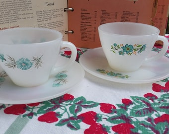 2 Fire King teacups with saucers