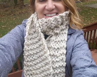 A light wheat colored fringe scarf