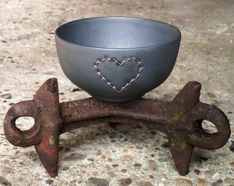 Handmade matt black ceramic bowl with silver wire embroidered heart