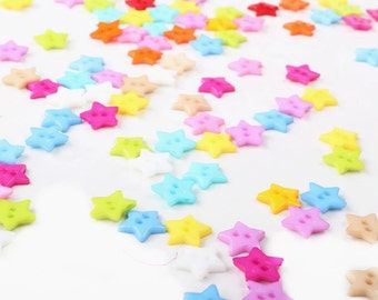 15 star-shaped plastic buttons