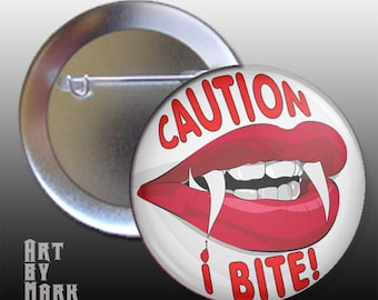 Caution I Bite vampire red lips pin back button badge