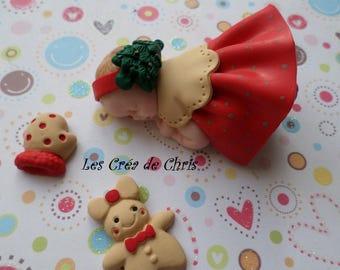 """baby girl-themed fimo """"Christmas."""