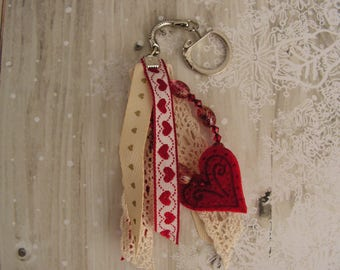 Red and off-white keys or jewelry bag little hearts