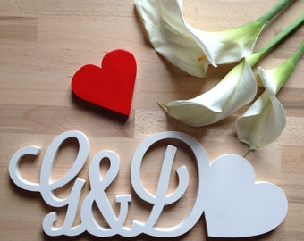 Initials in wood to decorate the house or for ceremonies