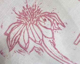 Hand printed pink teatowel in Echinacea design