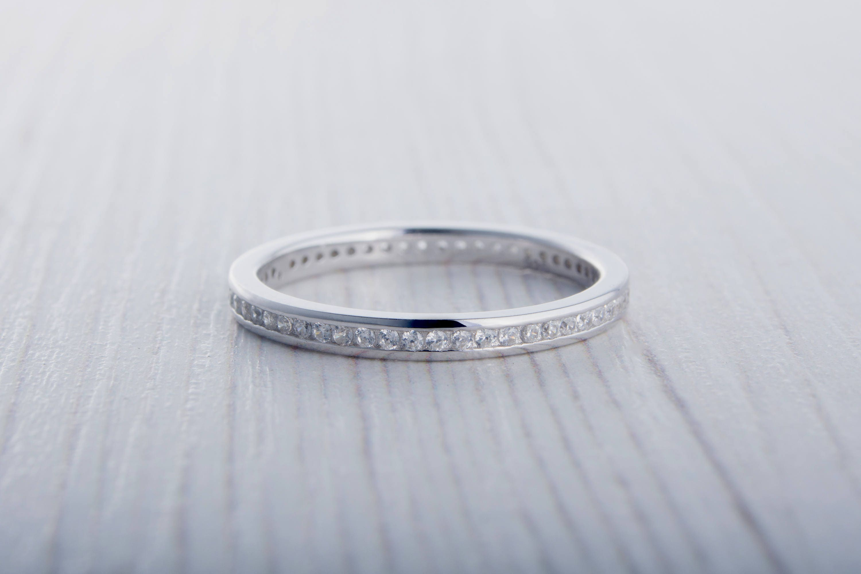 eternity bands wide a white round diamond jewelers rings bezel made an on carat gold in redford engagement band pin set at custom with ring