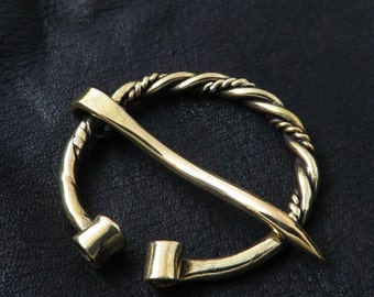 Brass fibula. Viking brooch.
