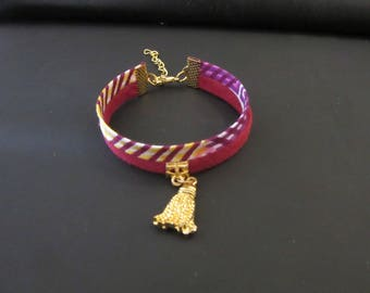 Double wax and gold tassel charm bracelet