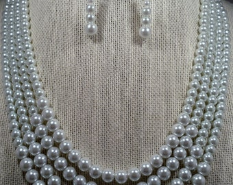 Multi stranded pearl necklace and earring set