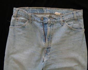 Vintage Levi's 550's 34x30 zipper fly light blue