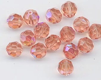 Check this out - twelve vintage Swarovski peach AB crystals - Art. 5000 -8 mm - so rare