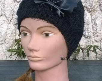 Black warm woolen hat for winter, with a faux leather bat and black veil