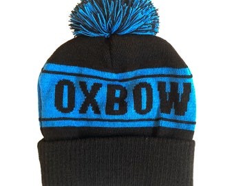 Blue on Black Oxbow Knit Pompom Beanie