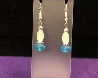 Blue and opaque silver toned drop earrings.