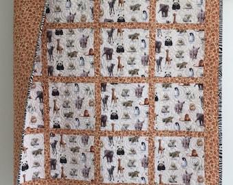 Baby Quilt featuring Animal Babies Elephants Panda Bears Giraffes Zebras, Owls, Rhino, Penguins, Seals in Black White Brown Tan