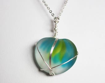 Wire wrapped art glass pendant with sky blue and apple green glass and silver wire