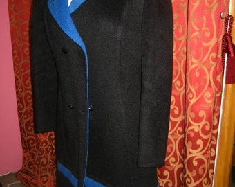 "1970's, 36"" bust, wool alpaca double breasted coat, black with bright blue strip at knee."