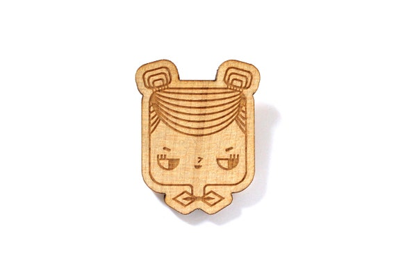 Wooden brooch Judith - girl with hair buns and bowtie - lasercut maple wood accessory - illustrated graphic jewellery - lasercut jewelry