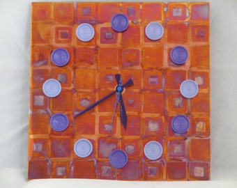 Game board inspired copper clock, with painted checkers as hour markers with purple hour and minute hands, with a blue second hand