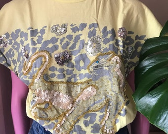 Yellow Tshirt with leopard print and rhinestones.
