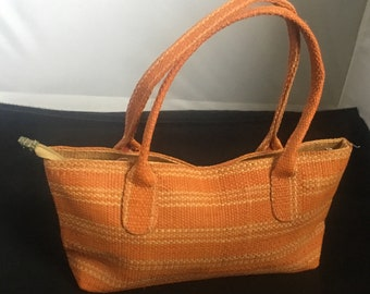 Orange raffia purse