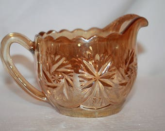 S2 Marigold Carnival Glass Creamer Unknown Maker or Age Pinwheel Style
