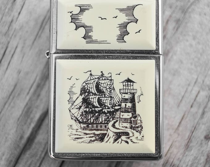 Scrimshaw Zippo with sailing ship and lighthouse Made in Canada