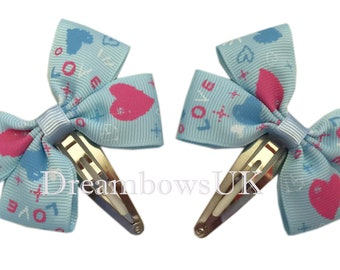 Baby blue ribbon bows on snap clips, Heart design ribbon hair accessories, Baby hair clips and slides, Pretty hair accessories for girls
