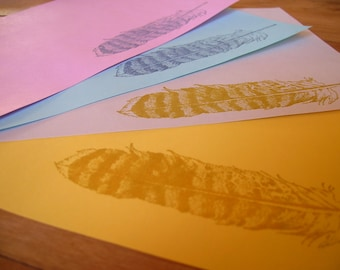 blue feather letter set stationery on pink, yellow, aqua paper with envelope ready to write a penpal