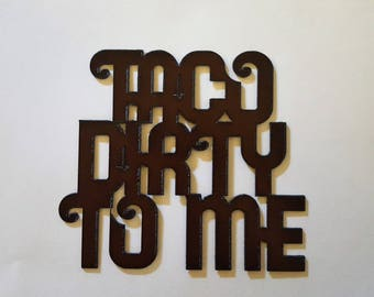 Taco Dirty to Me rusted metal sign