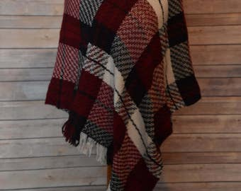 Dress up or dress down in this handwoven poncho of Merino, silk and wool.