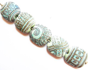 SILVERED COPPER TRIBE    5 copper green and silvered ivory matte finish large squeezed   A Beaded Gift