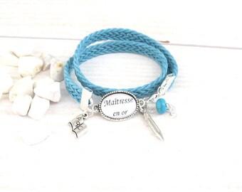 centerpiece gold blue for a teacher braided cord bracelet