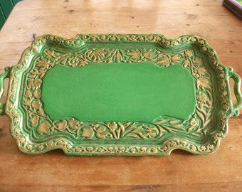 Solid wood carved tray, painted, distressed and enhanced with gold leaf.