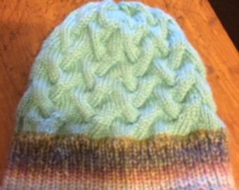 Cabled hat in waterfall and robin egg blue.