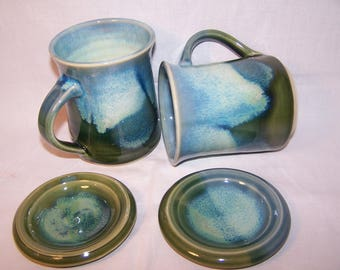 Stoneware Mug with lid.  Height Approx. 11 cm.Capacity 400 mls. Three Greens Glaze range.